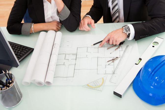Construction Project Team Reviewing Architectural Plans