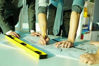 building project design team marking up plans