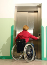 Lady in wheelchair using passenger lift